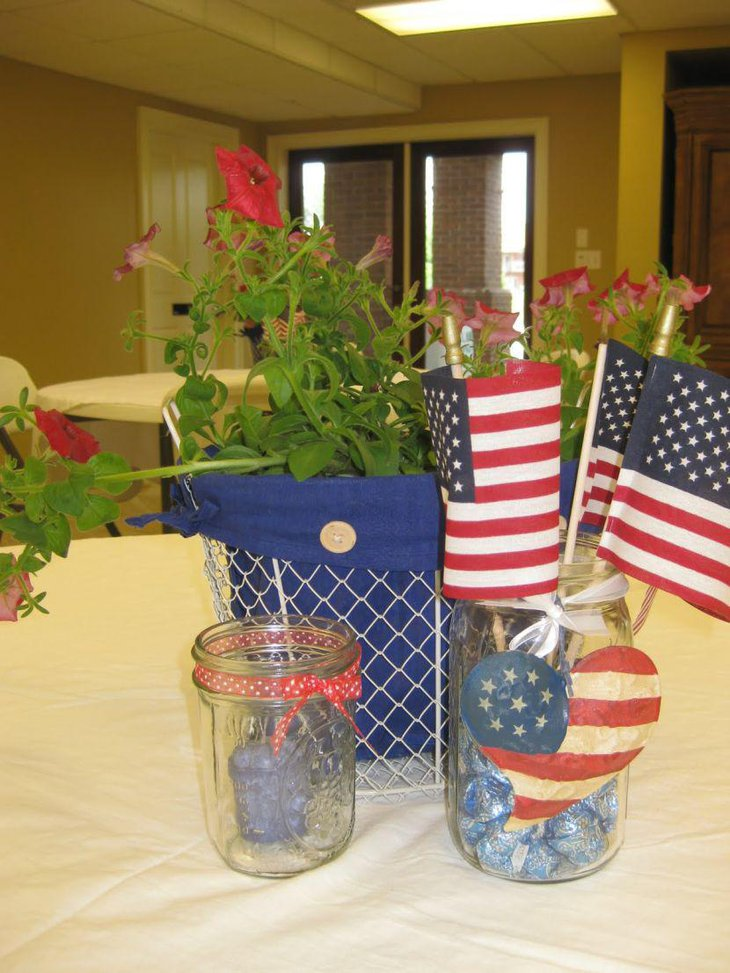 4th of July retirement party table decor with mason jars and flowers