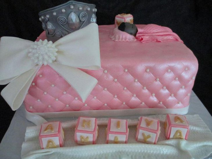A baby shower cake for a little princess with a cute bow