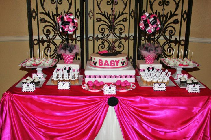 A baby shower cake with Minnie Mouse as its theme
