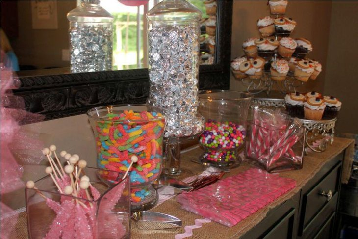 A baby shower candy table with a delectable spread of candies