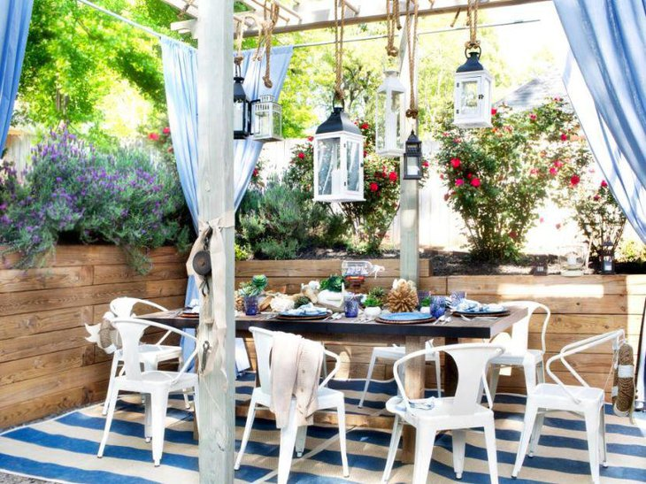 A blue accented beach themed outdoor bridal shower table
