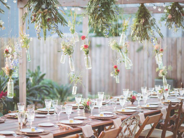 A floral themed outdoor bridal shower table