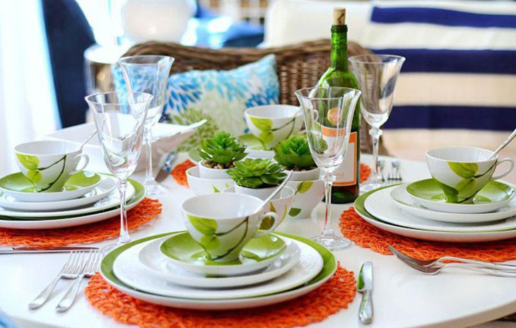A layered colour table setting in green and white accents