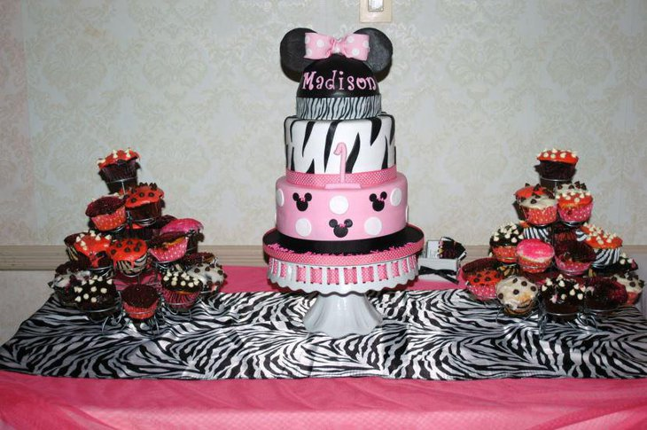 A Minnie Mouse cake adorned with black stripes