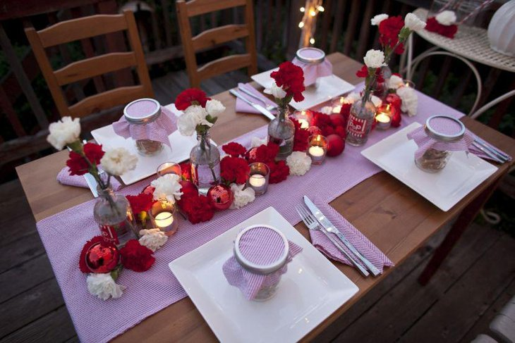 A red and white floral Christmas tablescape