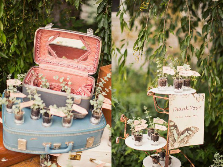 A rustic vintage themed outdoor bridal shower table decked up with makeup vanity and suitcase