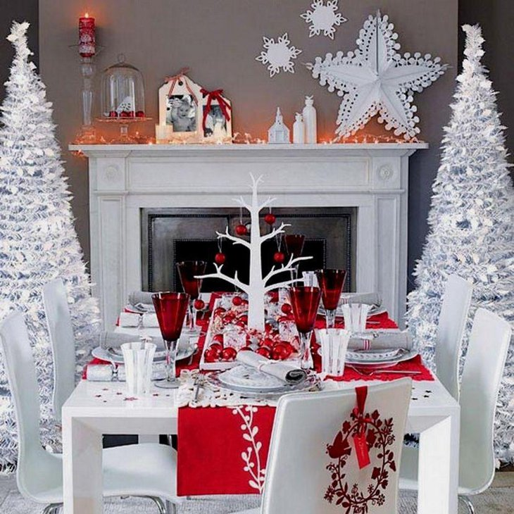 A stylish red and white Christmas table adorned with a white tree and red baubles