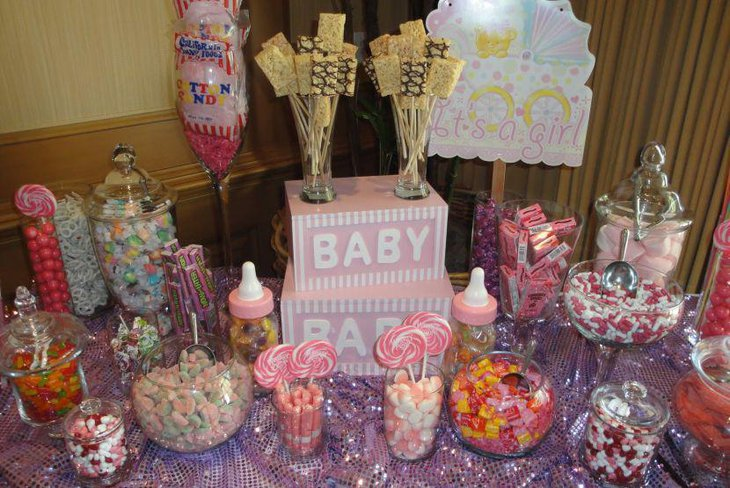 A very delicious spread of baby shower candies in different colours