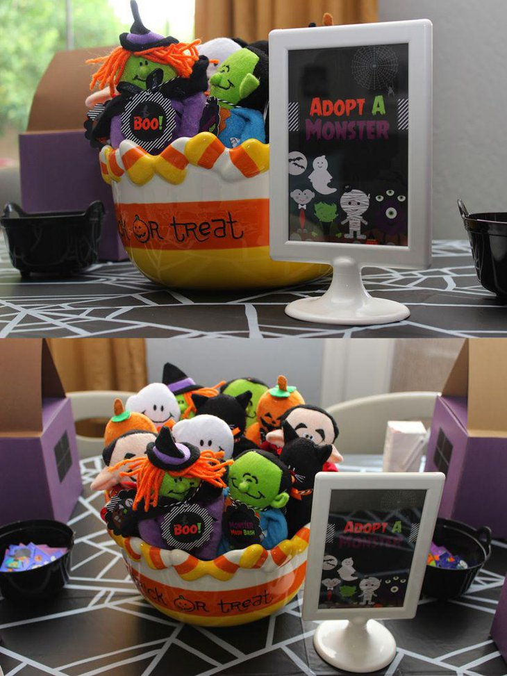 Adopt a monster bowl centerpiece for kids Halloween party table