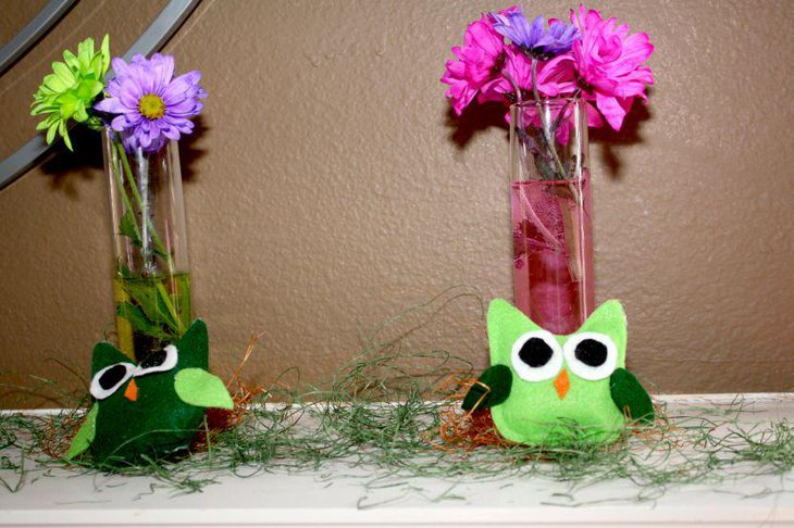 Adorable green owl centerpieces with flowers