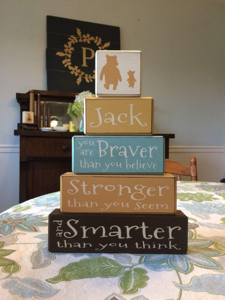 Adorable Winnie The Pooh layered box centerpiece idea for baby shower