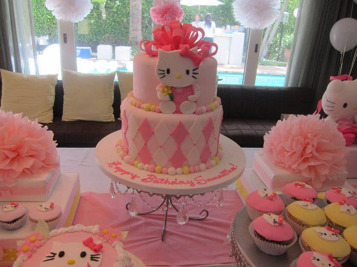 Adorned with pretty pink ribbons a Hello Kitty cake for a baby shower