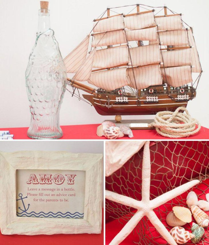 Ahoy nautical baby shower table decor with sailboat and sea shells