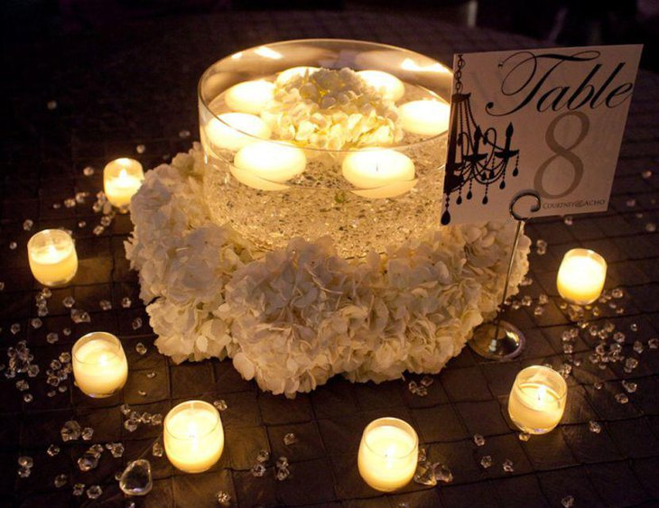 Alluring wedding tablescape with glass candle jar and votives