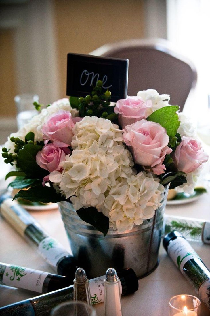Amazing flowers in Galvanized Buckets As Wedding Table Centerpiece