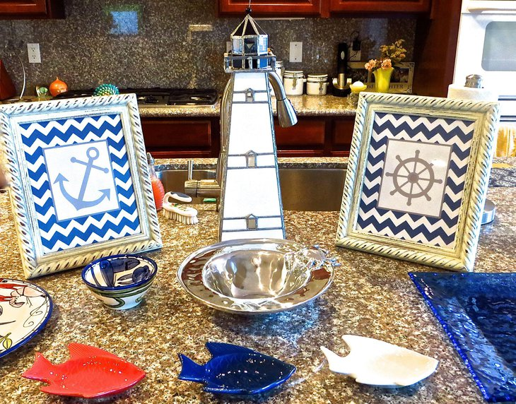 Amazing nautical themed baby shower decor with lighthouse