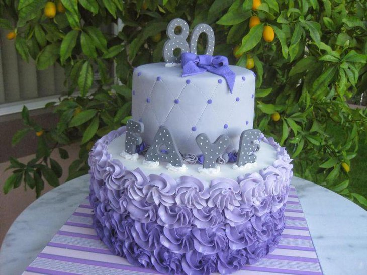 Amazing white and purple cake display on an 80th birthday table for a beloved mother