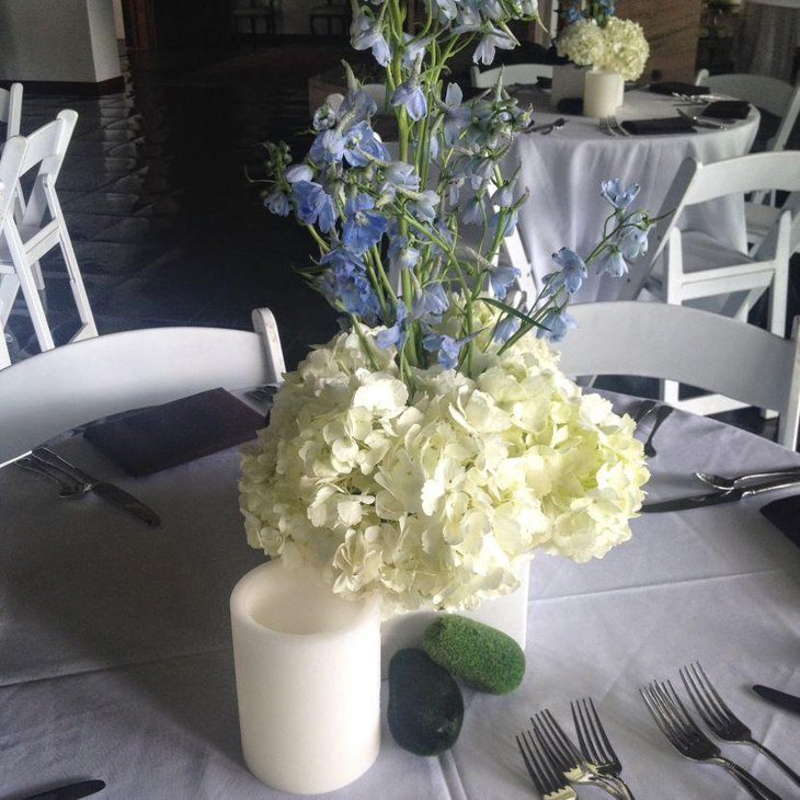Amazing white and purple floral spring table centerpiece