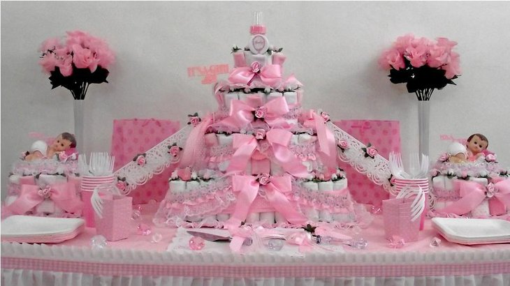 An elaborate baby diaper cake announcing the arrival of a girl