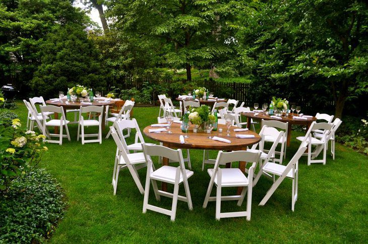 An outdoor bridal shower party tables adorned with fresh flowers