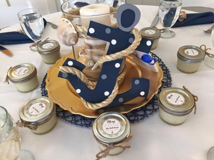 Anchor and candle centerpiece on nautical themed baby shower table