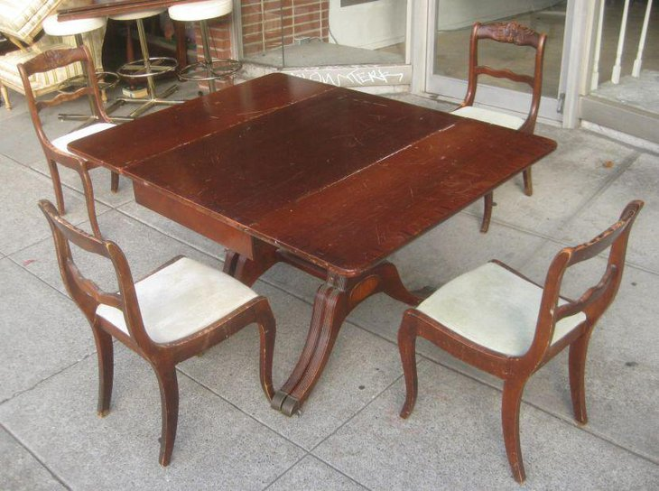 Antique Duncan Phyfe drop leaf dining table set