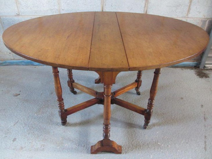 Antique oval drop leaf dining table design