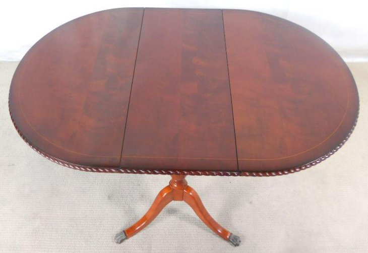 Antique oval mahogany drop leaf dining table design