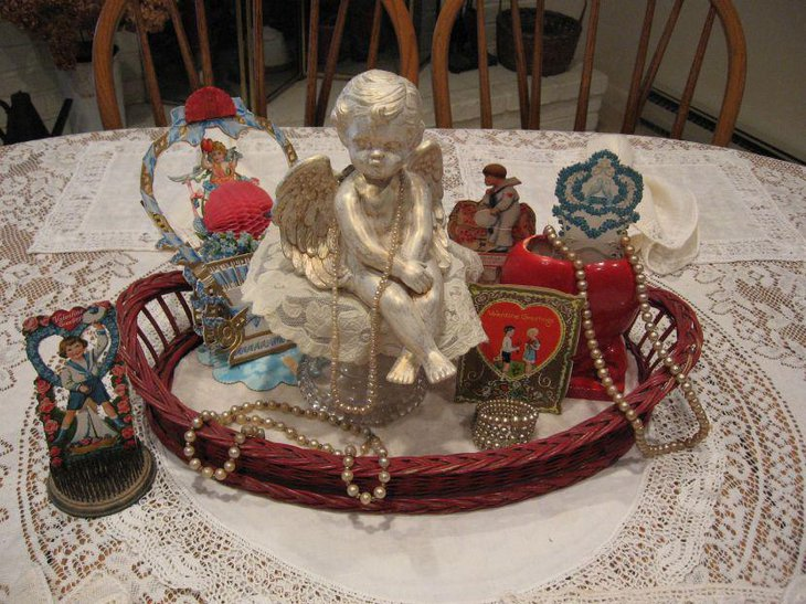 Antique vignette centerpiece on Valentines table