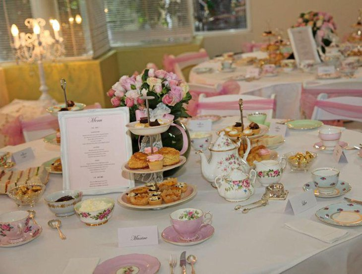Appealing birthday table decor with pink accented flowers and cups