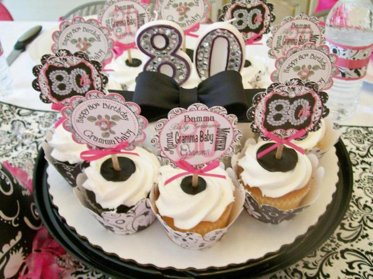 Appealing cupcake centerpiece decor on 80th birthday table