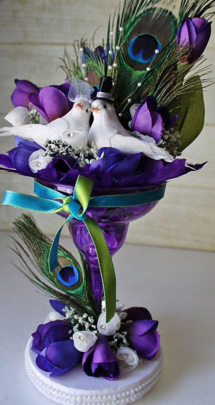 Appealing peacock themed purple wedding table centerpiece