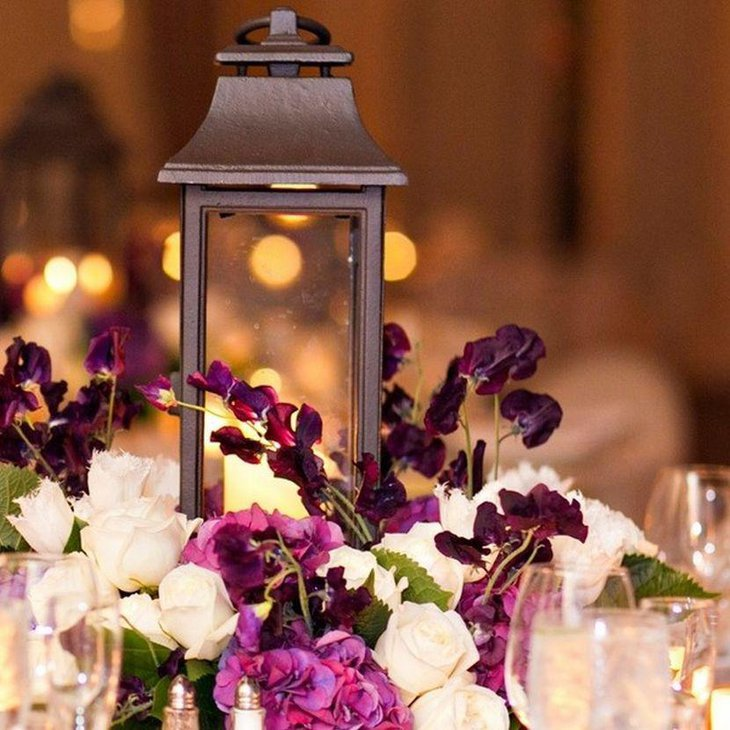 Appealing purple flowers and lantern decor for wedding table