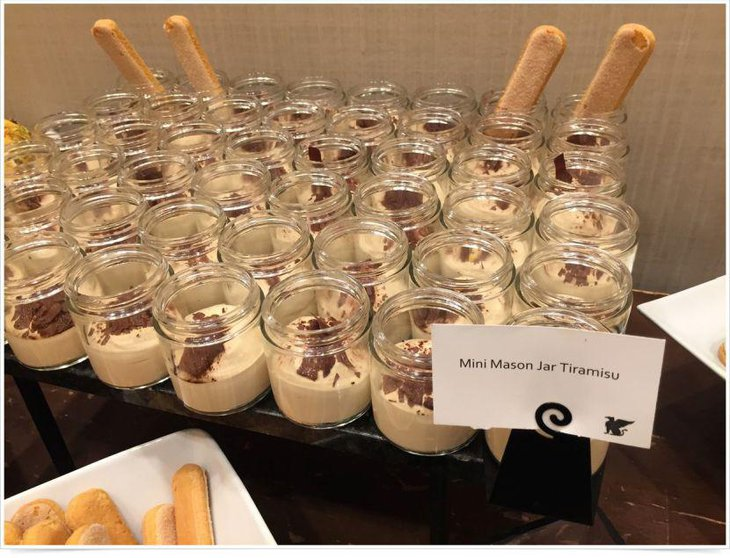 Appetizing dessert table setup with mason jars