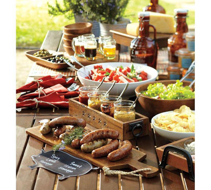 Appetizing food table setting for summer garden party