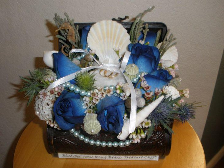 Aqua and white treasure chest wedding centerpiece with beach theme