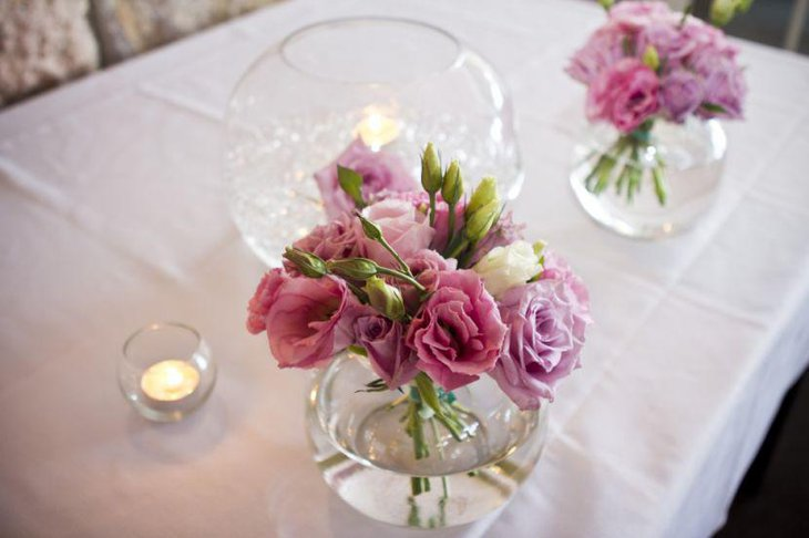 Astonishing Fish Bowls With Pink Floral Arrnagement As Dining Table  Centerpiece
