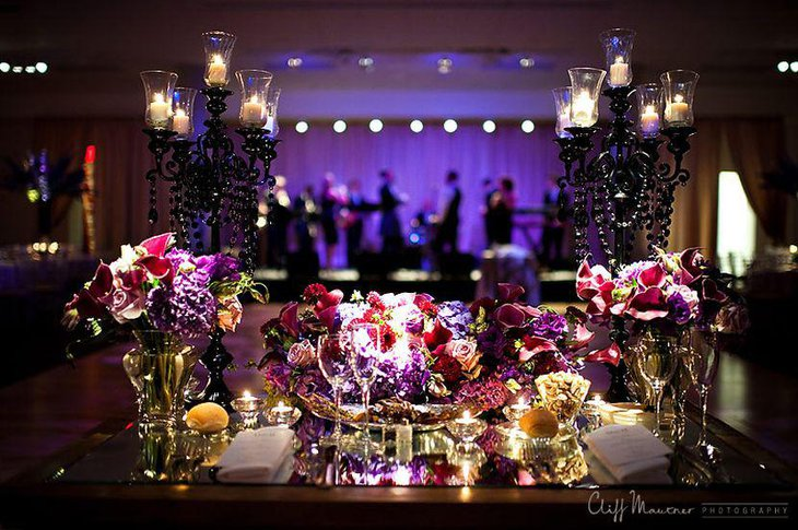 Astonishing purple wedding table decor with flowers and candle stands