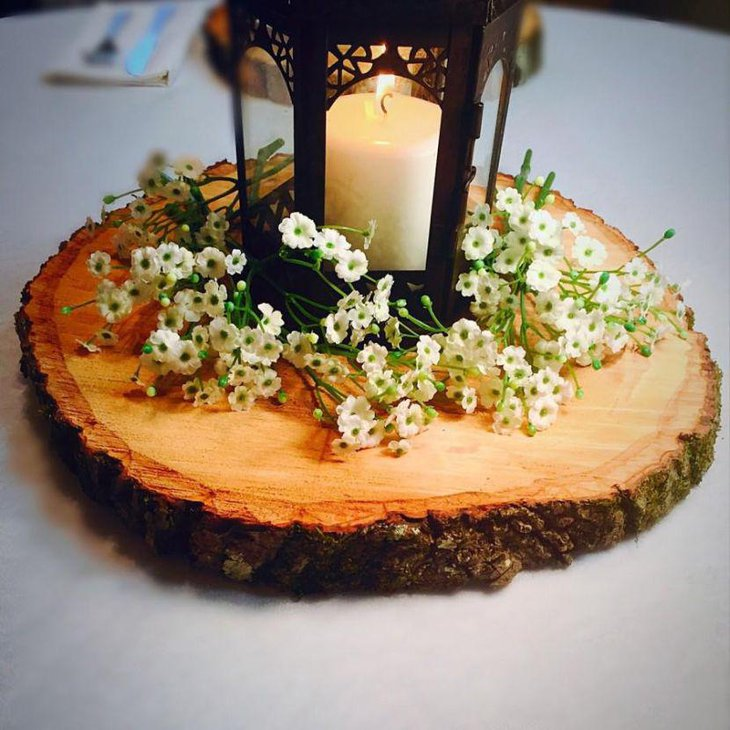 Astonishing wooden slab and candle lantern centerpiece