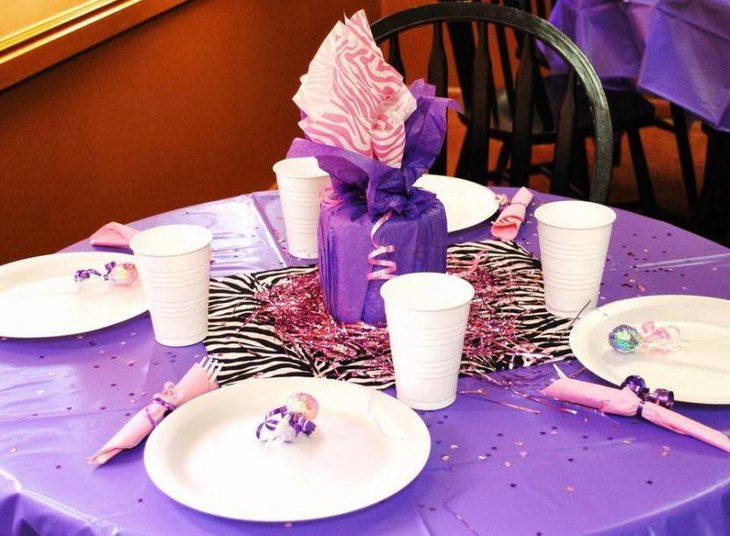 Attractive purple gift table centerpiece for girl baby shower