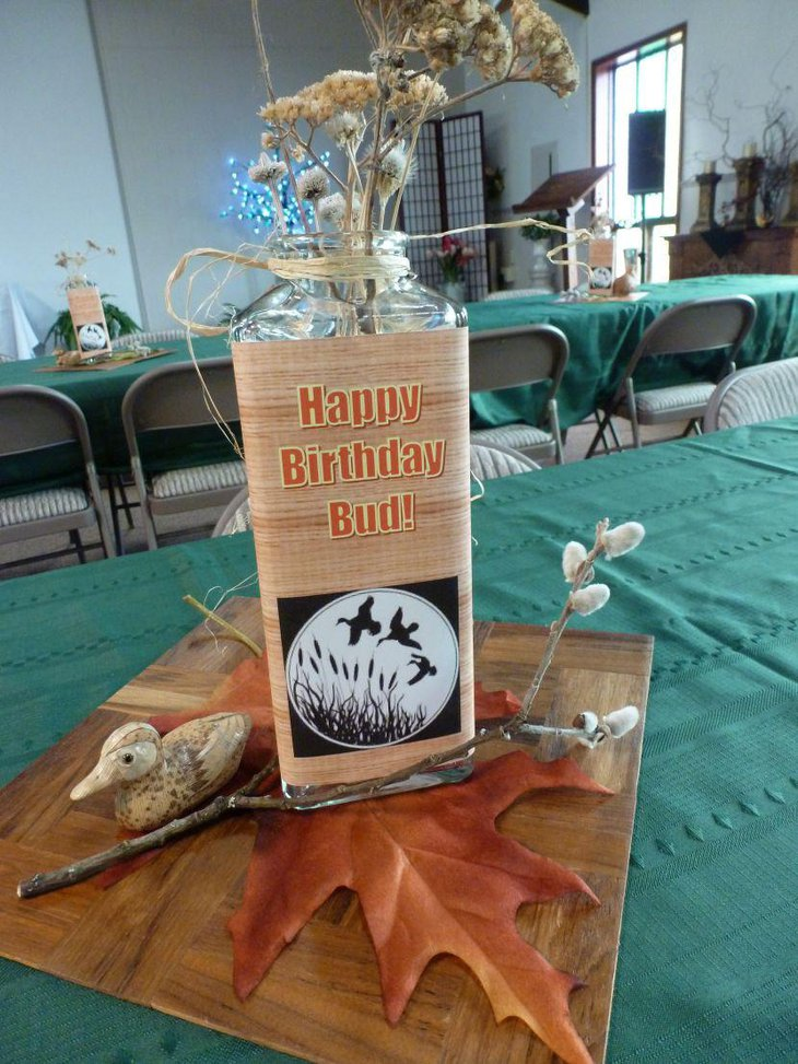 Awesome bird jar and willow centerpiece on 80th birthday table of a loved dad