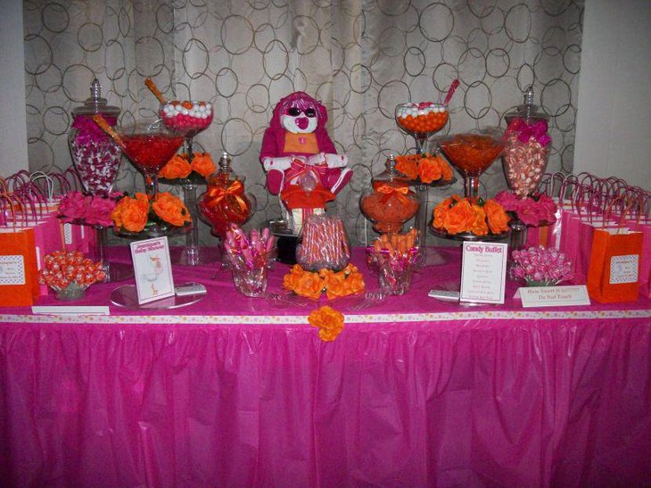 Awesome pink themed baby shower candy tablescape with pink favor bags toy and candies