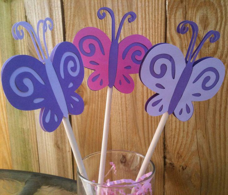 Awesome purple and pink butterfly straw centerpiece on baby shower table