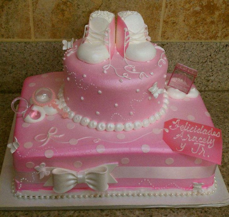Baby shower cake for a little princess full with baby shoes and pacifier