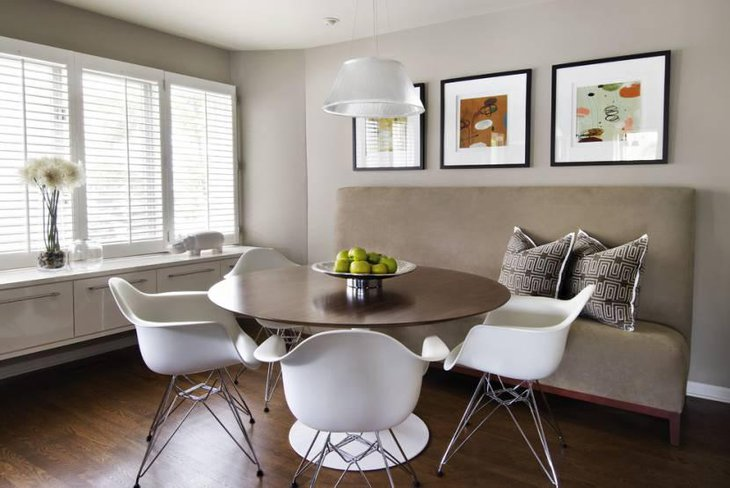 Banquette Breakfast Nook With Beautiful Artwork