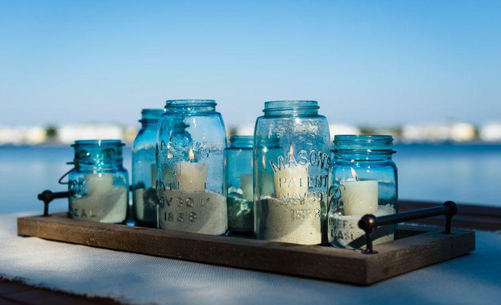Beach themed candle and mason jar wedding table decoration