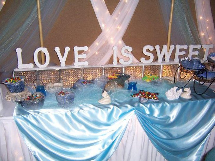 Beach themed candy buffet wedding table centerpieces