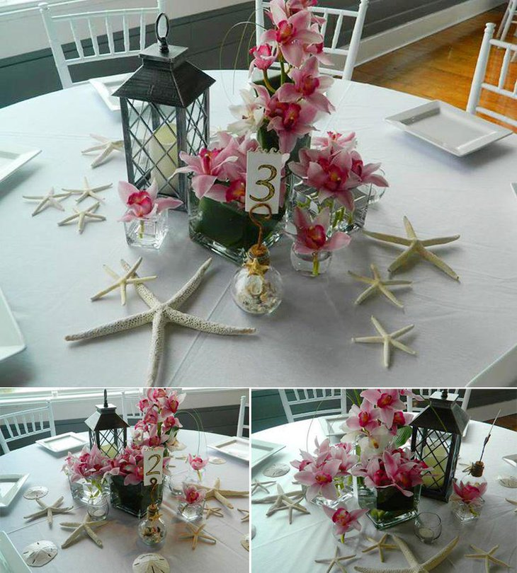 Beach themed wedding table decor with starfish and flowers