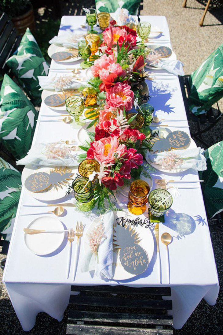 Beautiful and colorful flower arrangement on outdoor party table