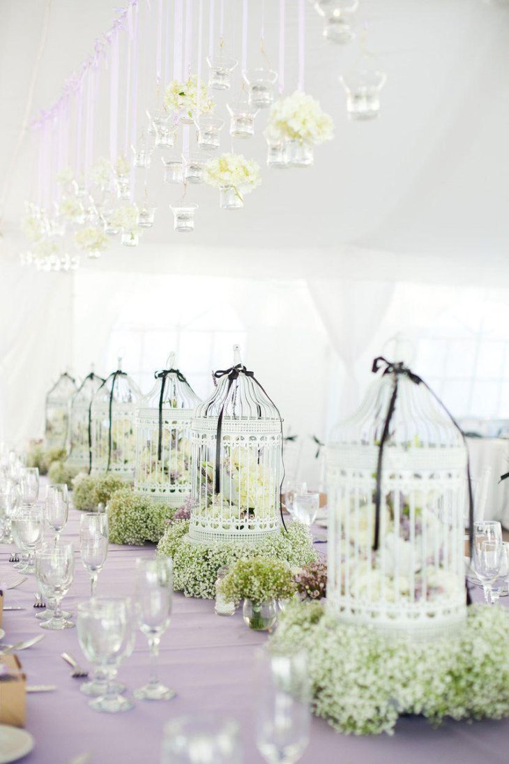 Beautiful birdcage centerpieces with greens and flowers